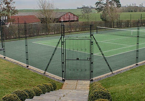 A mitred corner gate saves space and allows easy court access