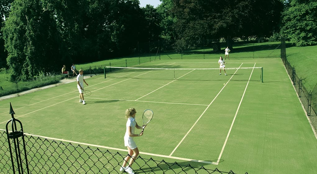 Foursomes on a tenns court built by En Tout Cas. Cotswold Tennis Courts. Fake grass.
