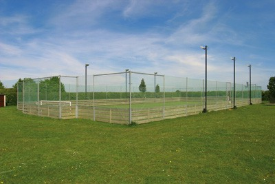 Multi Use Games area with hockey boards. En Tout Case. Cotswold Courts. Fake grass.