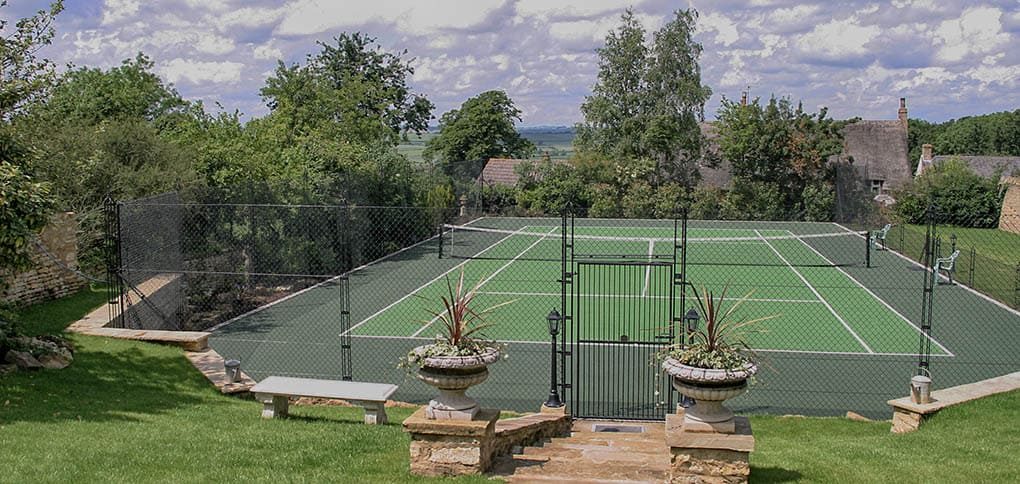 Tennis curt construction Cotswolds - obelsik fencing and synthetic grass, fake grass