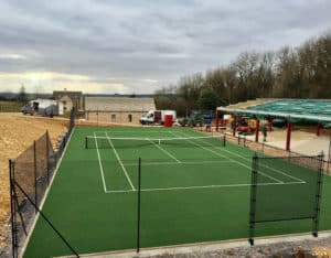 En Tout Cas tennis court fencing. Eastate fencing on a new court.